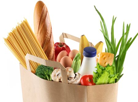 buying a paper bag of vegetables products .