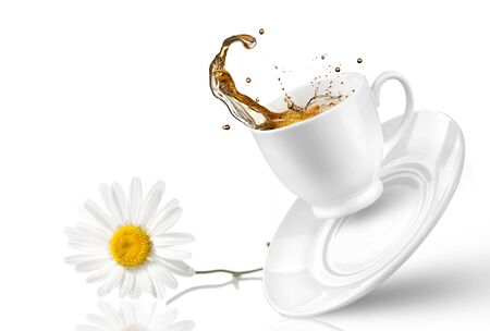 cup of tea spray drops chamomile on a white background .