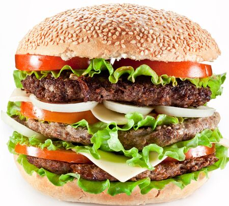 Hamburger fast food 3 cutlets on a white background .