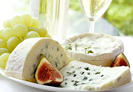 cheese with moulded wine fruit grapes .