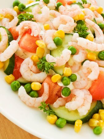 salad with seafood shrimp vegetables on a plate .