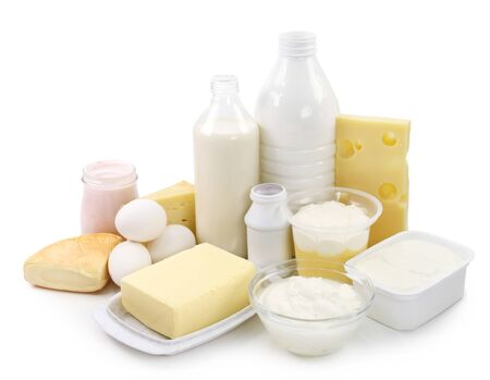 Dairy milk, eggs, cheese, butter, yogurt, sour cream and dressing on white background.