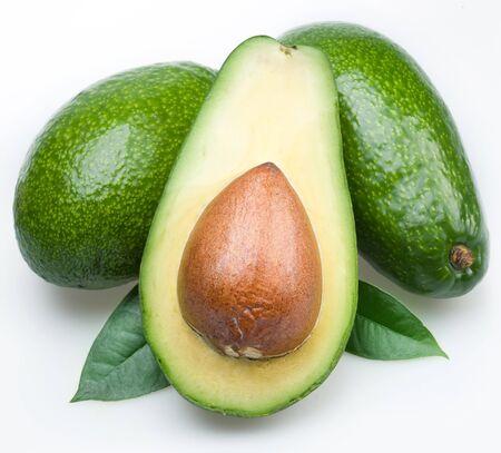 Avocado in cut half pulp bone white background .
