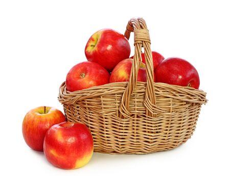 Apples basket woven fruit on white background . Imagens