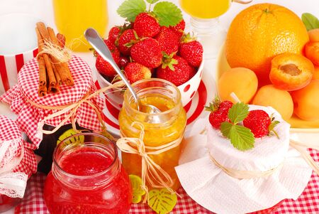 Jam and fruits on the table. Imagens