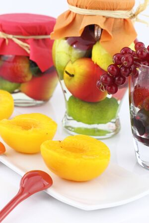 glass jar fruit on white background. Imagens