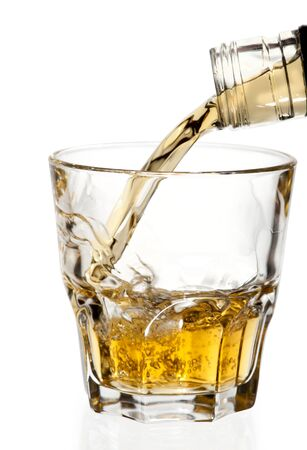 Lemonade whiskey brandy drink in glass on a white background .