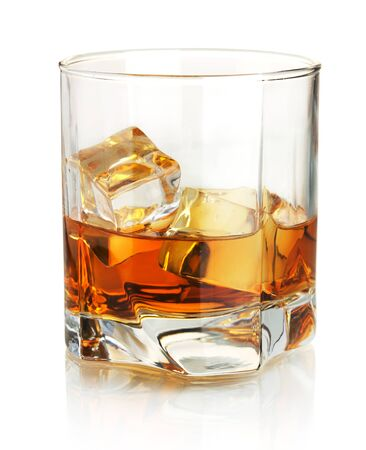 Whisky brandy ice in glass on white background.