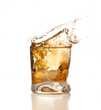 Drink lemonade whiskey brandy in glass on a white background. Imagens