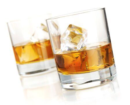 Whisky brandy lemonade in glasses on white background.