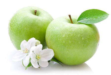 Apples green with a leaf droplets of fruit on a white background.