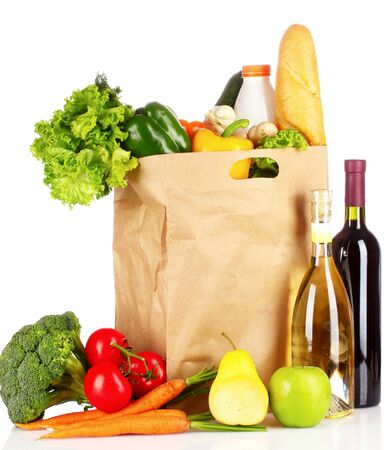 Foods pack buying fruit and vegetables on a white background .