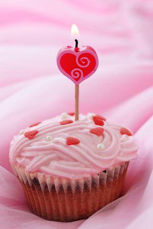 Cupcake on pink background.