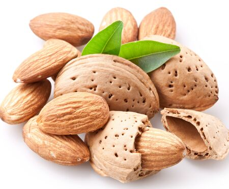Almonds with leaf on white background. Imagens