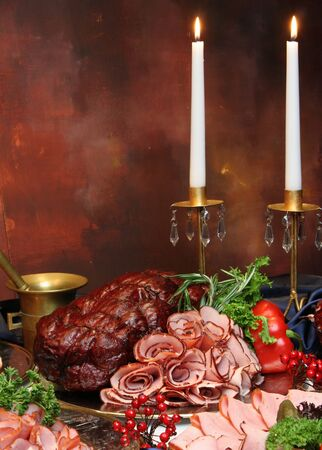 Table dinner with meat, chicken, wine, candle and bottle glasses. Imagens