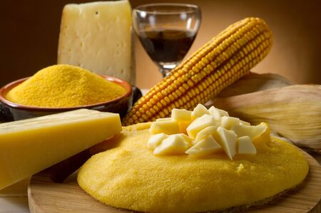 dinner with corn, cheese and glass of wine. Imagens