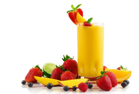 Juice fresh smoothie and fruit on a white background .