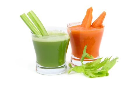 Fresh juice smoothie vegetables celery carrot greens on a white background .