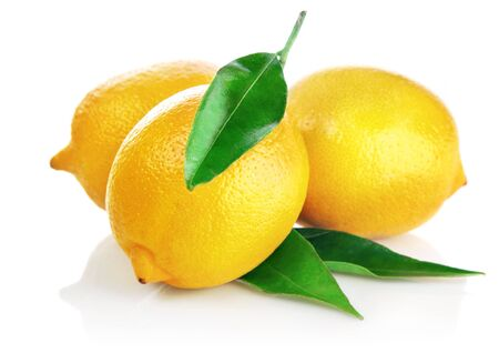 Lemons citrus fruit with leaves on a white background . Imagens