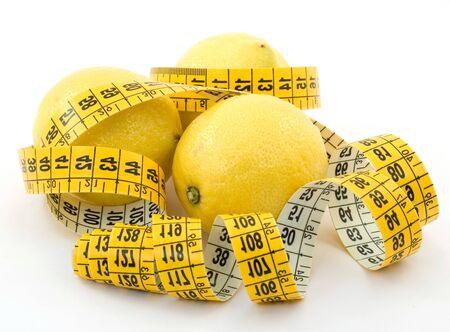 Lemons citrus fruit and centimeter on a white background . 免版税图像