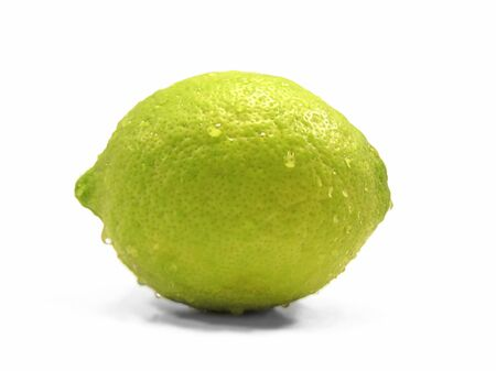 Lemon lime citrus fruit drops water white background .