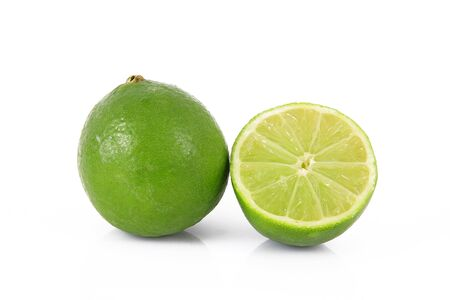 Lime citrus lemon fruit in cut halves on white background .