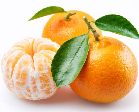 Tangerine citrus fruits with leaf wedges on a white background .