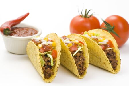 Tacos Meat Vegetables Spice Pepper Tomatoes Mexican Garlic Food on White Background . Imagens - 131596193