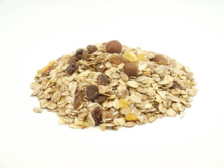 oatmeal flakes raisin nuts on a white background . Imagens