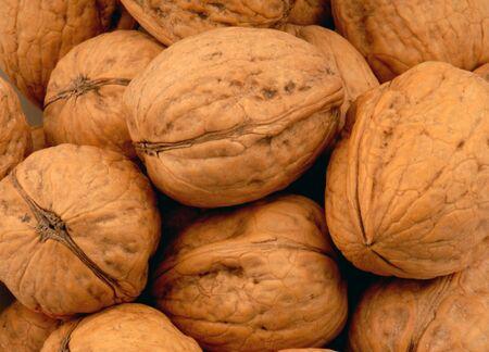 Walnut walnuts close-up grey background .