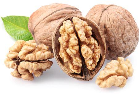 Walnuts walnut core half leaf white background .