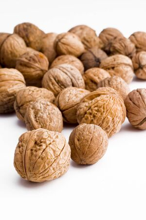 Walnuts on a white background . Imagens