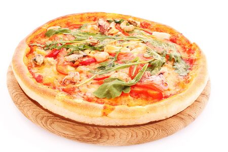 Pizza meal dinner dinner cheese tomatoes greens on white background . Imagens