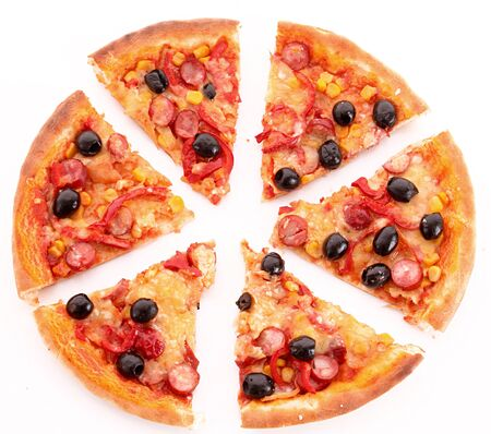 Pizza meal dinner slices olives corn tomatoes sausage white background . Imagens