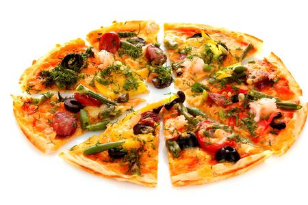 Pizza slices meal dinner dinner asparagus greens olives pepper sausage white background .