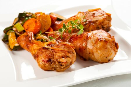 Chicken shin dinner dinner vegetables on a white background platter .
