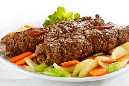 Meat roll vegetables meal dinner dinner greens on white background .