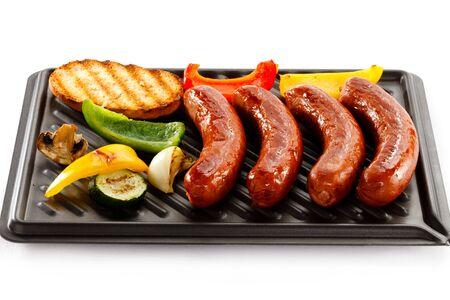 Sausage sausagefried grilled mushrooms pepper vegetables white background .