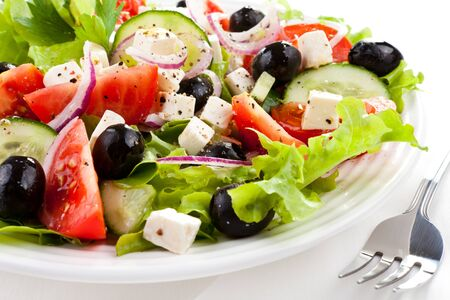 Greek tomato salad cucumbers onion olives cheese cheese white background .