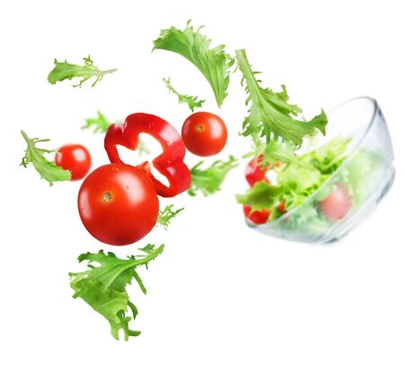 Vegetables greens tomato pepper salad white background .