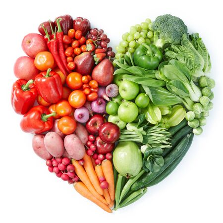 Vegetables fruit berries heart green red half apples white background . Imagens - 131597887