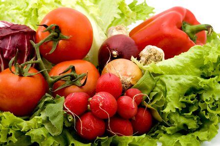Vegetables set to radish tomatoes pepper onion . Stockfoto