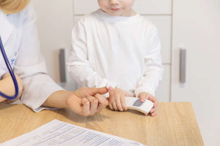 child being checked by a doctor. Selective focus