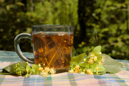 Cup with linden tea on a textile napkin  photo