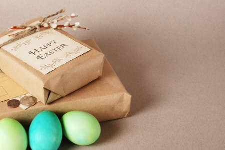 Vintage still life with easter eggs and gift boxes in craft paper photo