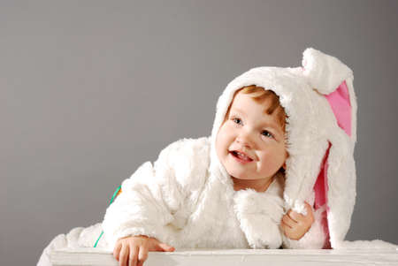 cute little girl dressed in Easter bunny suit photo
