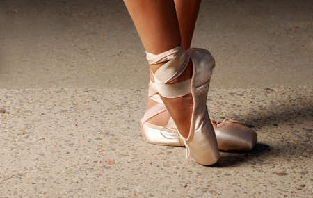 Feet of ballerin dancing in ballet shoes Stock Photo