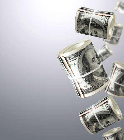 dollar: Rotoli Di Cento Dollar Bills. Soldi Astratto Archivio Fotografico