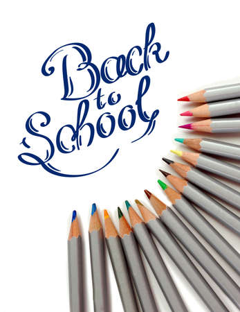 Sharpened monochrome pencils with multicolor slate-pencil on a white background with hand drawn Back to School title. closeup photo