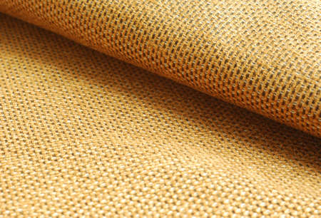 Reddish yellow Chenille fabric waved textile background. Stock Photo